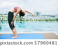 Yoga near the swimming pool 57960481