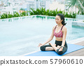 Woman sitting in lotus position 57960610