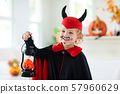 Child in Halloween costume. Kids trick or treat. 57960629