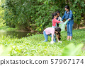 Group family asian children collecting garbage  57967174