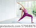 Asian women workout practicing yoga training put 57968876