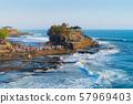 Pura Tanah Lot, the water temple, in Bali at noon. 57969403
