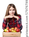 Teen girl with apples and pears in a box 57976799