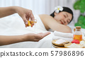 Leisure asian young woman in spa salon. 57986896