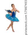 Girl ballerina dancing while read book. Ballet 57987403