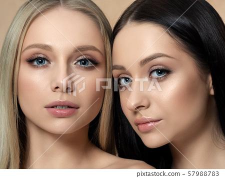 Portrait of two young beautiful caucasian women 57988783