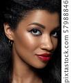 Young beautiful black woman with evening makeup 57988846