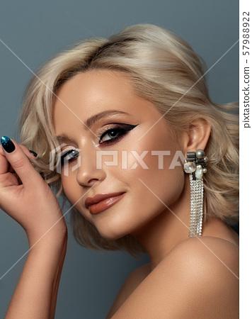 Portrait of beautiful woman with fashion make up 57988922