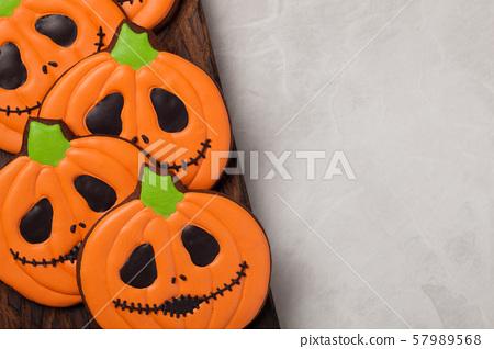Halloween pumpkin and bats cookies. 57989568