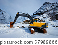 Old excavator in winter 57989866