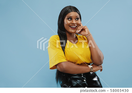 African-american young woman's half-length portrait on blue background 58003430
