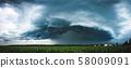 Panoramic view of a terrifying dark thunderstorm 58009091