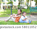 Portrait of cute little Asian sister and her 58011052