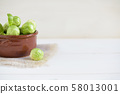 a pile of Brussels sprouts on a white background 58013001