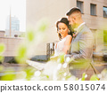 Caucasian romantic young couple celebrating their marriage in city 58015074