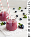 Two jars of blueberry smoothie 58015297