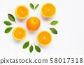 Fresh orange citrus fruit with leaves isolated 58017318