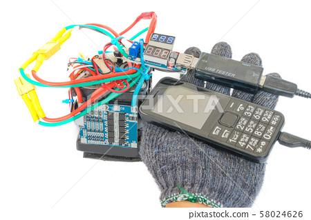 Old mobile phones, batteries DIY power banks and digital volt ammeter test. 58024626