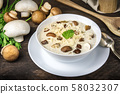 Mushroom soup with ingredients on a dark rustic wooden background 58032307