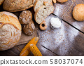 fresh bread and wheat on the wooden 58037074