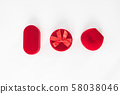 Three red closed jewelry boxes on a white 58038046