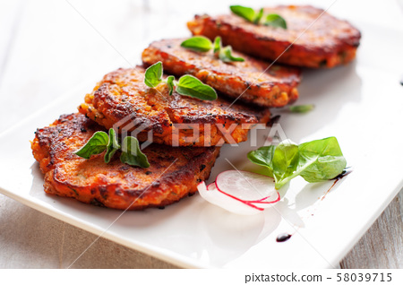 Fried salmon and sweet potato patties 58039715