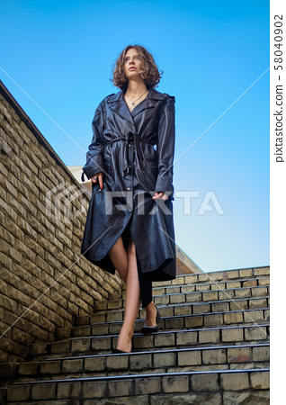 Beautiful woman descending the stairs 58040902