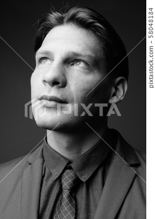 Studio shot of businessman shot in black and white 58048184
