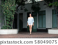 Outdoor full body fashion portrait of young 58049075