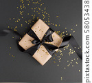 Gift or present box and gold stars confetti on 58053438