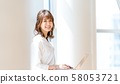 Businesswoman, office, laptop 58053721