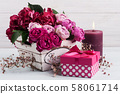 Red hydrangea flowers and pink roses 58061714
