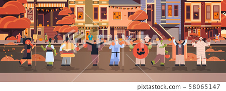 people wearing different monsters costumes walking in town tricks and treat happy halloween party 58065147