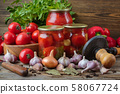 Fresh and pickles ripe tomatoes and sweet red bell 58067724