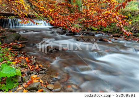 Mountain waterfall in autumn forest 58069891