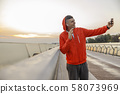Smiling sportive young boy taking a selfie 58073969