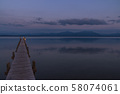 Wooden pier leaks into the lake chiemsee 58074061