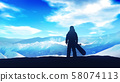Dark silhouette of a snowboarder on a background of snowy mountains. 58074113