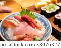 sashimi seafood on plate at restaurant 58076827