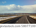 Highway in winter snow covers the desert  58077100