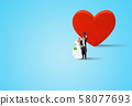 Miniature figurine character as Bride and Groom posing in posture with red heart in background. 58077693