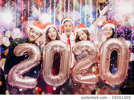 young group celebrating new yew 2020 in christmas 58081808