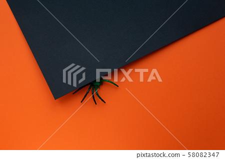 Halloween concept. Orange black background with spider. 58082347