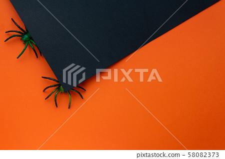 Halloween concept. Orange black background with spiders. 58082373