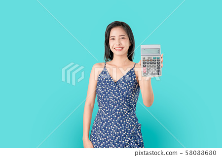 Smile Asian woman holding calculator isolated. 58088680