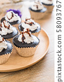 chocolate cup cake with whipped cream 58093767