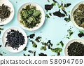 Various dry seaweed, sea vegetables, shot from the top on a teal background forming a frame for copy 58094769