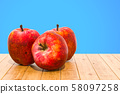 Red Apples close-up 3d rendering 58097258