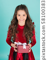 Happy child with long brunette hair hold present 58100383