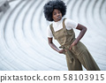 Young and beautiful black girl on an urban 58103915